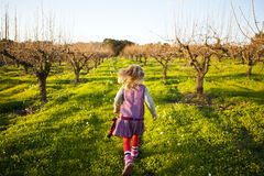 Little girl running outdoors Royalty Free Stock Images