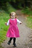 Little girl running Stock Image