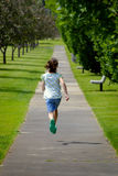 Little Girl Running in Park Stock Photography