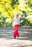 Little girl running in park Royalty Free Stock Photos