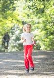 Little girl running in park Stock Photography