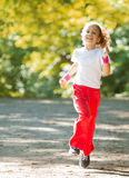 Little girl running in park Royalty Free Stock Images