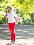 Little girl running in park Royalty Free Stock Image