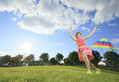 Little girl running in park with a kite Stock Photo