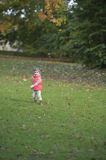 Little girl running in a park Stock Photography