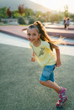 Little girl is running in the park Stock Photography