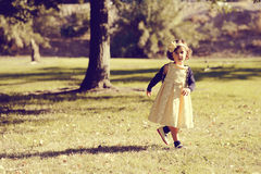Little girl running and playing in the park Royalty Free Stock Photography