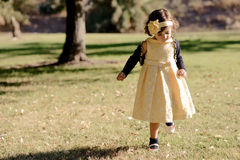 Little girl running and playing in the park Royalty Free Stock Images