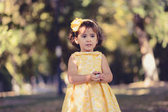 Little girl running and playing in the park Stock Photography