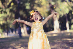 Little girl running and playing in the park Stock Photos