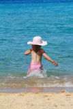 Little girl running in sea Stock Photo