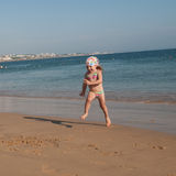 A little girl running into the sea water Royalty Free Stock Photo