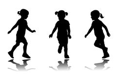 Little girl running silhouettes Stock Photos