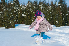 Little girl running in the snow in winter, lifestyle, winter holidays Royalty Free Stock Photo