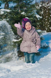 Little girl running in the snow in winter, lifestyle, winter holidays Royalty Free Stock Photos