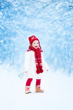 Little girl running in a snowy park Royalty Free Stock Photography