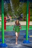 Little Girl Running in Splashpad Royalty Free Stock Image
