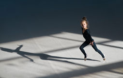 Little girl running in  sports hall Royalty Free Stock Photos