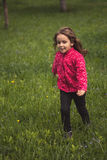Little girl running in a spring plum orchard Royalty Free Stock Images