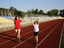 Little girl running on the stadium royalty free stock photography