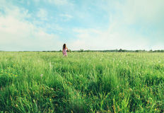 Little girl running on summer meadow Royalty Free Stock Image