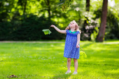 Little girl running in sunny park Royalty Free Stock Photo
