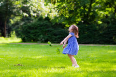Little girl running in sunny park Stock Images