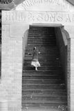 Little girl. Running up the stairs Stock Photo