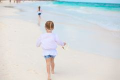 Little girl running on white sandy beach in Mexico Stock Images