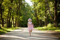 Little girl runs. Along a deserted mall Stock Photos