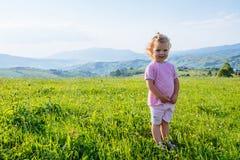 Little girl runs through a beautiful meadow Stock Photography