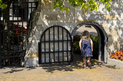 Little girl runs through a Child size gate royalty free stock photo