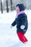 Little Girl Runs In Snow Park Stock Images