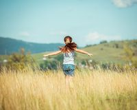 Little girl runs through a meadow Royalty Free Stock Images