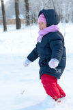 Little girl  runs in snow park Stock Images