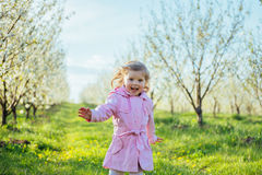 The little girl that runs in spring sunny day. Art processing an Royalty Free Stock Image