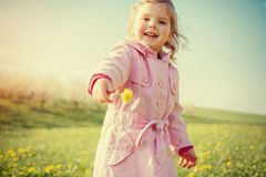 The little girl that runs in spring sunny day. Art processing an Stock Images