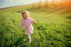 The little girl that runs in spring sunny day. Art processing an Stock Photography