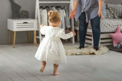 Little girl runs to her mother`s arms stock photography