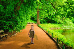 A little girl runs to meet. Royalty Free Stock Photos