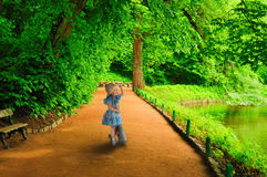 A little girl runs to meet. Royalty Free Stock Image