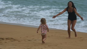 Little girl runs to mother and having fun stock video footage