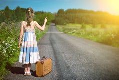Little girl on rural road. Stock Photo