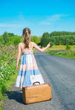 Little girl on rural road. Stock Photography