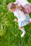 Little girl rushing to school Royalty Free Stock Images