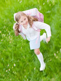 Little girl rushing to school Stock Image