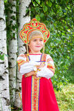 Little girl in Russian national a sundress Stock Image
