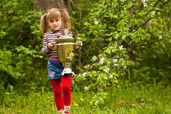 Little girl and Russian Samovar Royalty Free Stock Photos