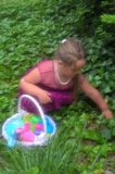 Little Girl`s Easter Egg Hunt stock image