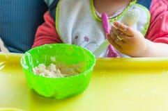 Little girl's eating mash stock image